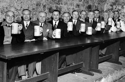 Brewery employees hoist a toast in rathskeller at Leisy Brewery, 1952