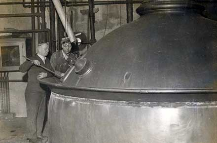 Workers at brew kettle inside the Cleveland Home Brewing Company