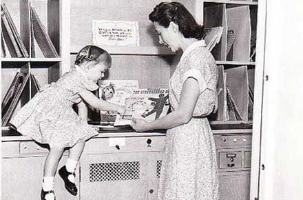 Woman and child in music room, 1955?