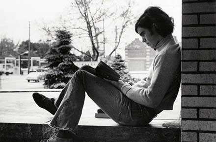 Young man reading in the browsing room, 1977