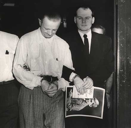 Convicted Dr. Samuel Sheppard is led away to a car, 1955
