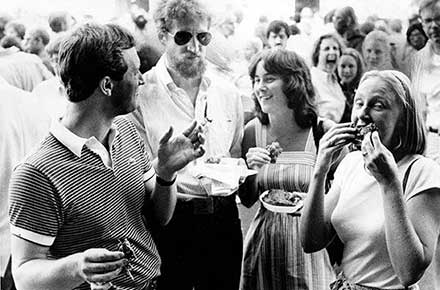 Folks enjoying ribs at the West Side Market, 1980