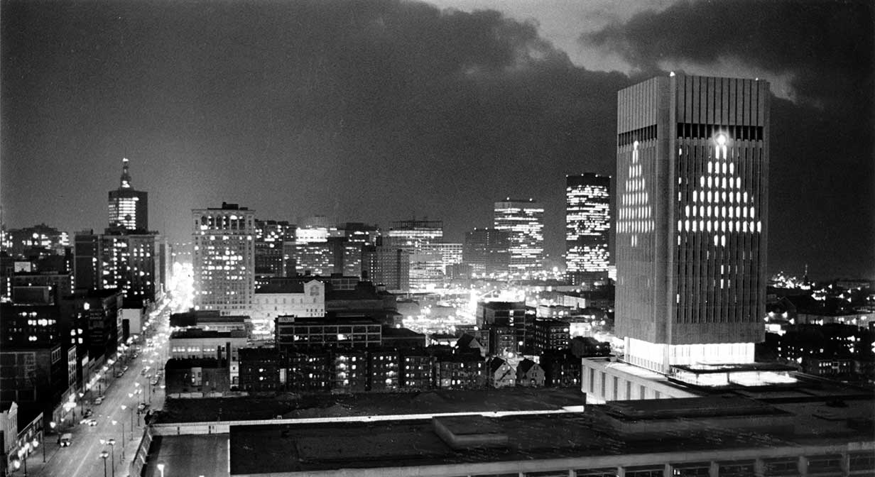 Rhodes Tower at CSU lit up as Xmas tree, 1972.