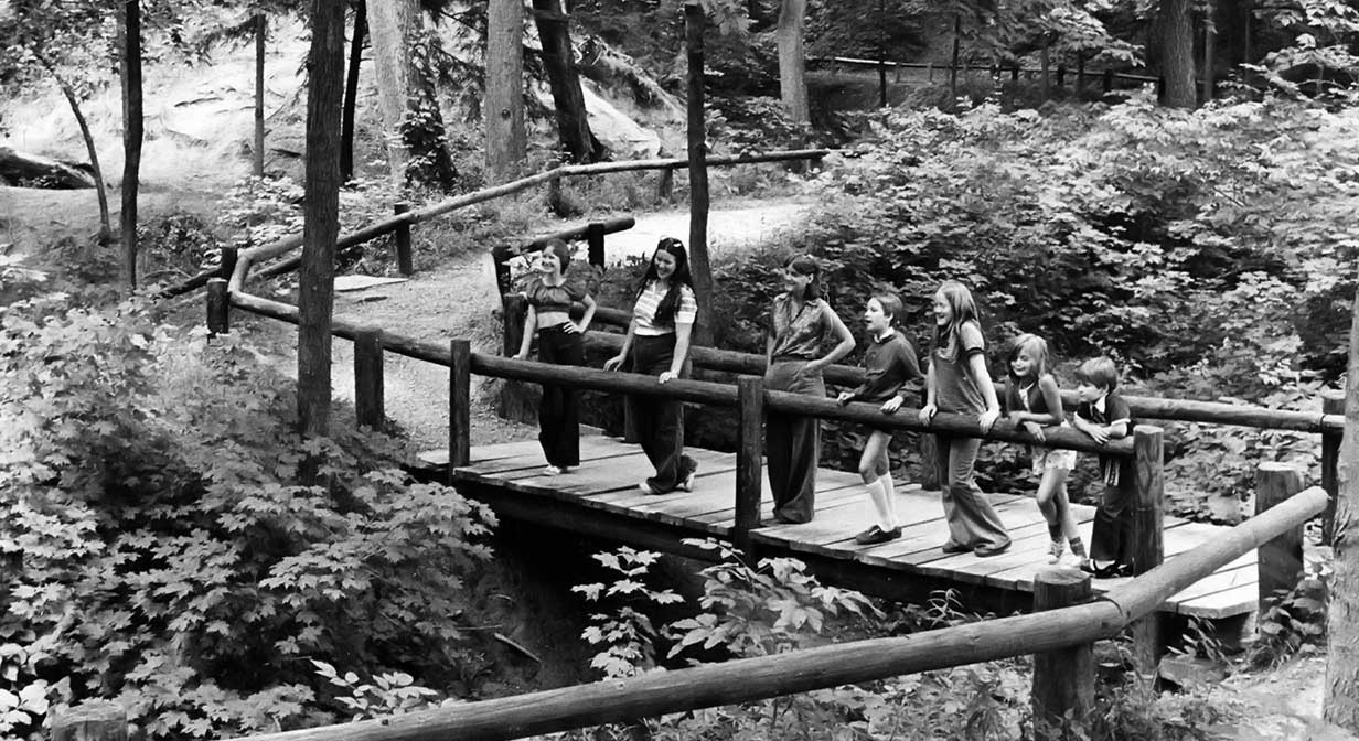 Children on a bridge behind Squire's Castle.