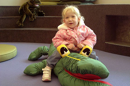 Young patron with a stuffed animal in children's area, 2001