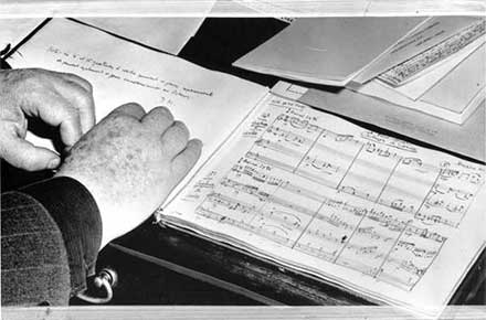 Darius Milhaud rests his hands on score for Octuor a Corde