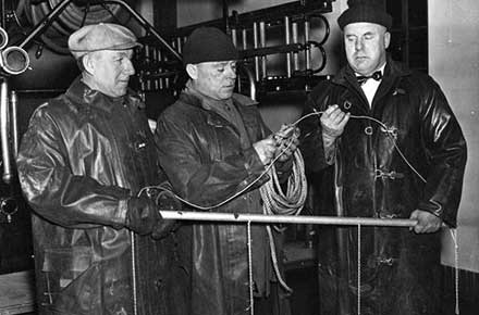 Parma firefighters holding equipment, 1939