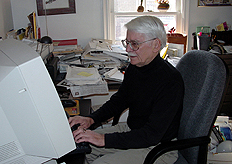 Roldo on computer at his desk