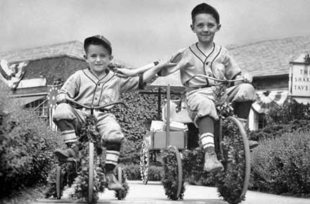 Francis and Donald Elliott on bikes at the Shaker Festival, 1936